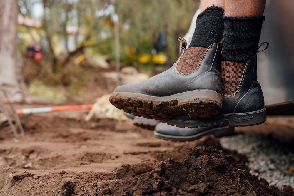 Photo showing Blundstone 600 work boots on a farm