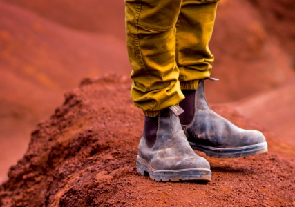 A pair of Blundstone 500 Originals Series boots in the desert